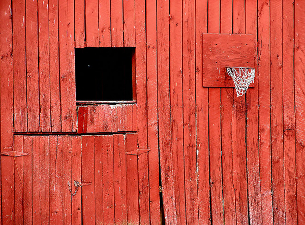 Old red building with window and basketball hoop