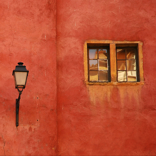 Orange wall with lamp and window