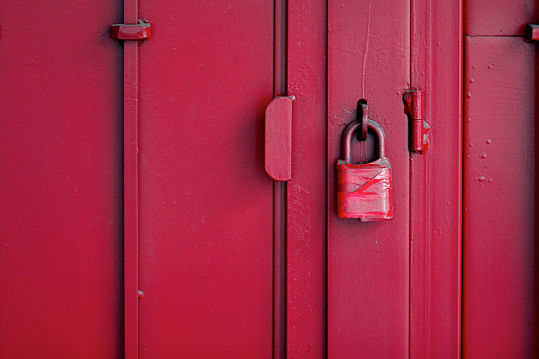Red door with padlock