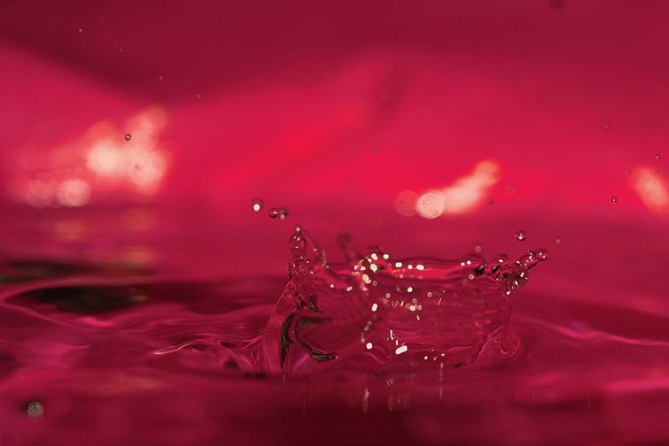 Water splash with red background