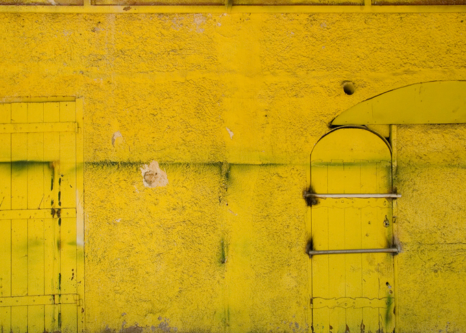 Yellow and aged wall and doors