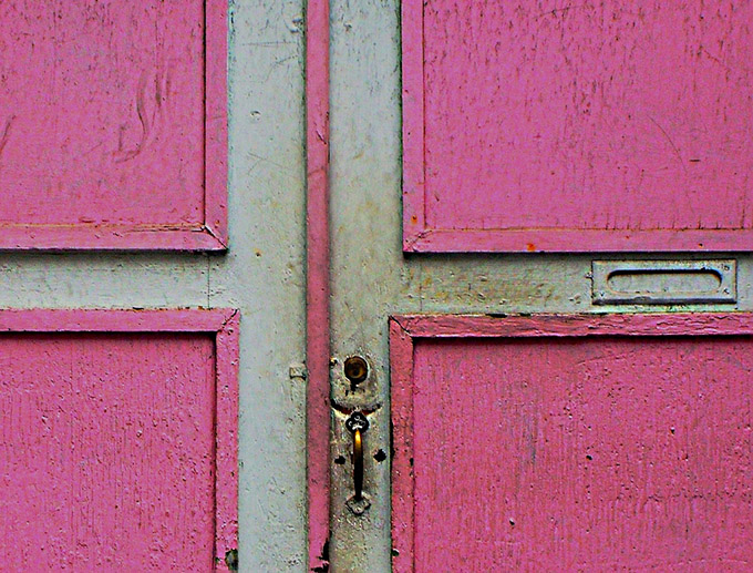 Weathered pink door