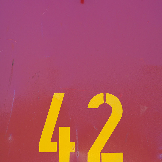 Purple painted metal with the number 42