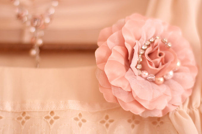 Fabric rose on a lace dress
