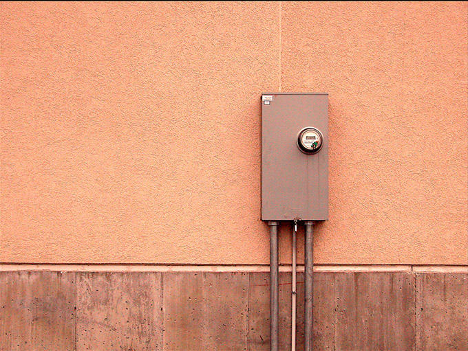 Electrical box on apricot coloured wall