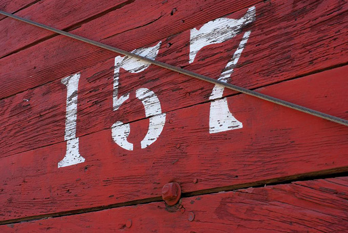 Red wood witht the number 157 painted in white